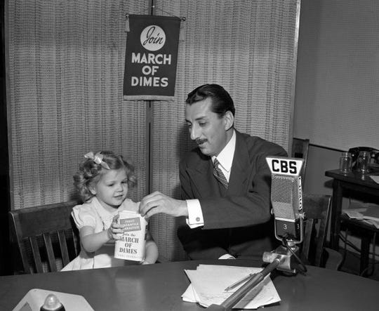 CBS Newsman Robert Trout with Nancy Drury, polio survivor and poster child for the March of Dimes on January 15, 1947.