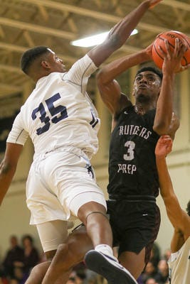Immaculata's Jordan Myers (35) defends against Rutgers Prep's Trey Patterson during their game on Thursday, Jan. 2, 2020.