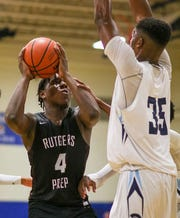 Rutgers Prep's Nico Galette (4) goes to the basket against Immaculata's Jordan Myers on Thursday, Jan. 2, 2020.