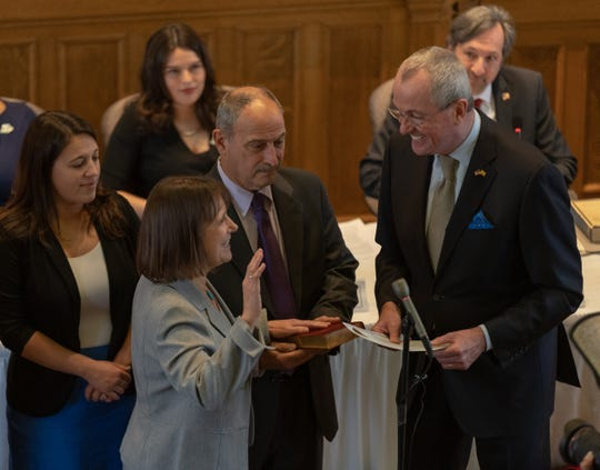 Gov. Phil Murphy swears in new freeholder Melonie Marano, giving Democrats control of the freeholder board for the first time since 1965.