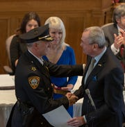 Gov. Phil Murphy swears in retired Franklin Police Lt. Darrin Russo as sheriff, giving Democrats control of the office for the first time in a half century.