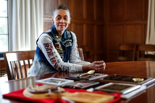 Kanda Fletcher, daughter of Korean War POW and Army Pfc. Robert Fletcher, smiles as she looks at her father's memorabilia and plaques at First Presbyterian Church of Ann Arbor, Thursday, Jan. 2, 2020.