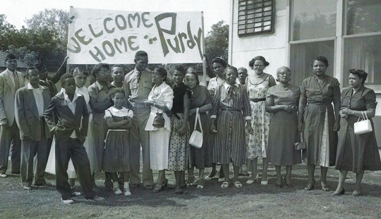 Army Pfc. Robert Fletcher is welcomed home to Ypsilanti by family members after the Korean War in 1953. He spent nearly three years in a POW camp.
