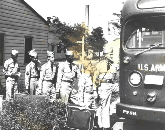 Robert Fletcher, fourth from left, boards a bus to Army basic training in 1950. Fletcher served during the Korean War and was held as a prisoner of war for nearly three years.