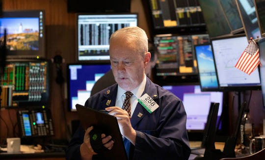 James Riley monitors stock prices at the New York Stock Exchange, Thursday, Jan. 2, 2020. Global shares rose Thursday on optimism about a U.S.-China trade deal and the Chinese government's efforts to boost its economy.