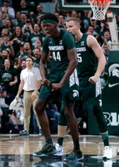 Michigan State's Gabe Brown (44) and Thomas Kithier celebrate a play against Illinois during the second half of MSU's 76-56 win on Thursday, Jan. 2, 2020, in East Lansing.
