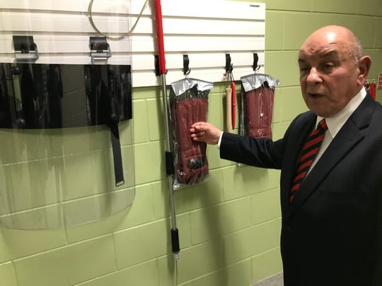 Oakland County Animal Control Manager Bob Gatt on Jan. 3, 2020 shows new safety gear added after a pit bull attack in the shelter, including a clear plastic shield and heavy gloves covering forearms.