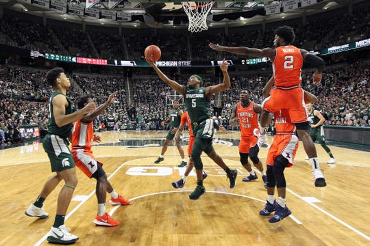 Michigan State guard Cassius Winston drives to the basket in front of Illinois forward Kipper Nichols during the first half of MSU's 76-56 win on Thursday, Jan. 2, 2020, in East Lansing.