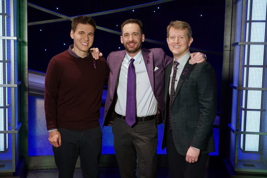 "In this image released by ABC, contestants, from left, James Holzhauer, Brad Rutter and Ken Jennings appear on the set of ""Jeopardy!"" in Los Angeles."