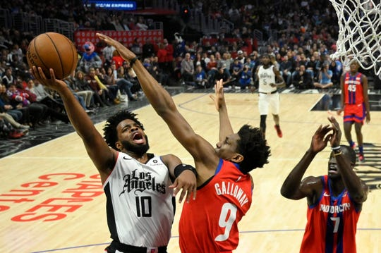 Los Angeles Clippers guard Derrick Walton Jr. shoots against Detroit Pistons guard Langston Galloway on Thursday night.