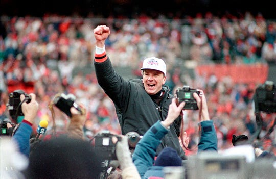 Bengals coach Sam Wyche is carried from the field after a 21-10 win over the Bills in the 1989 AFC title game.