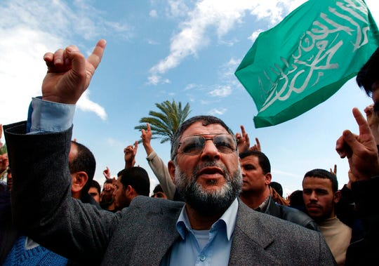 In this March 29, 2002 file photo, Hamas militant group leader, Abdel Aziz Al Rantissi, attends a demonstration in Gaza City.   Abdel Aziz al-Rantissi was also killed by an Israeli missile in the car he was traveling in near his home in Gaza.