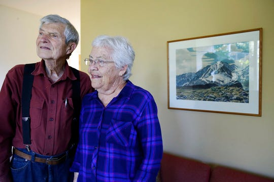 In this photo taken Tuesday, Oct. 22, 2019, Joan Busby, and her husband, Bill, pose at their home in Mill Valley, Calif. In 1945, Joan Busby's mother, Mary DeDecker spotted a branch among a jumble of rocks near Mount Williamson where she found the body of Giichi Matsumura.