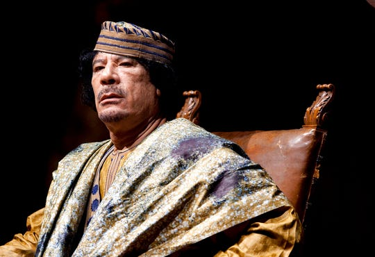 In this June 12, 2009 file photo, Libyan leader Muammar Gadhafi delivers his speech during a meeting with hundreds of prominent Italian women in a concert hall, in Rome.  Killings of major political and military figures have been a recurring factor in the modern Middle East, often presenting a defining moment and changing the contours of history in several instances.