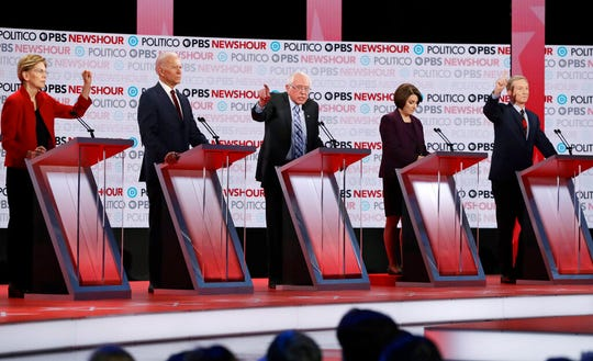 In this Dec. 19, 2019 file photo, Democratic presidential candidates from left, Sen. Elizabeth Warren, D-Mass., former Vice President Joe Biden, Sen. Bernie Sanders, I-Vt., Sen. Amy Klobuchar, D-Minn., and businessman Tom Steyer participate during a Democratic presidential primary debate in Los Angeles.