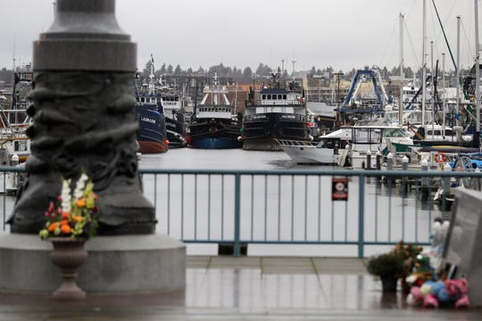 Fishing and boats used for other purposes are shown parked near the Seattle Fishermen's Memorial, Thursday, Jan. 2, 2020, in Seattle.
