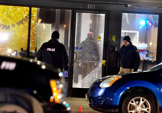 Huntington police officers investigate the scene of a shooting in Huntington, W.Va., Wednesday, Jan. 1, 2020. Police in West Virginia say several people were injured after a shooting at a bar in Huntington early New Year's Day.
