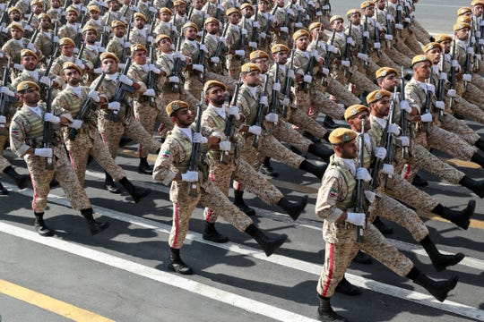 In this photo released by the official website of the office of the Iranian Presidency, Iranian army troops march at a military parade marking 39th anniversary of outset of Iran-Iraq war, in front of the shrine of the late revolutionary founder Ayatollah Khomeini, just outside Tehran, Iran, Sunday, Sept. 22, 2019.
