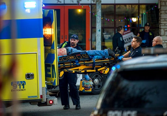 Paramedics transport a stabbing victim in Austin, Texas, on Friday, Jan. 3, 2020.