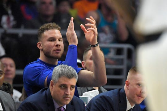 Detroit Pistons forward Blake Griffin claps from the bench during the second half.