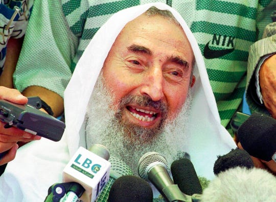 In this June 25, 1998 file photo, Sheik Ahmed Yassin, founder of the Islamic militant group Hamas, talks to the media in Gaza City.   Sheikh Ahmed Yassin was killed by a missile in his wheelchair after a prayer session in Gaza City.