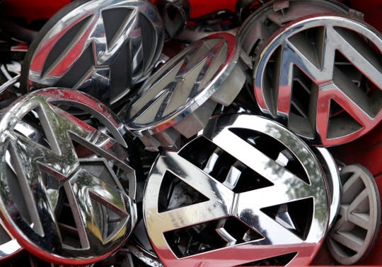 FILE - In this Sept. 23, 2015 file photo Volkswagen ornaments sit in a box in a scrap yard in Berlin, Germany.