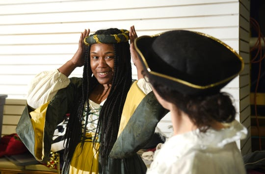 Participant Asia Johnson (left) portrays King Richard III as Frannie Shepherd-Bates, director of Shakespeare in Prison, don costumes as they prepare for their prison theater program out of the Detroit Public Theater.