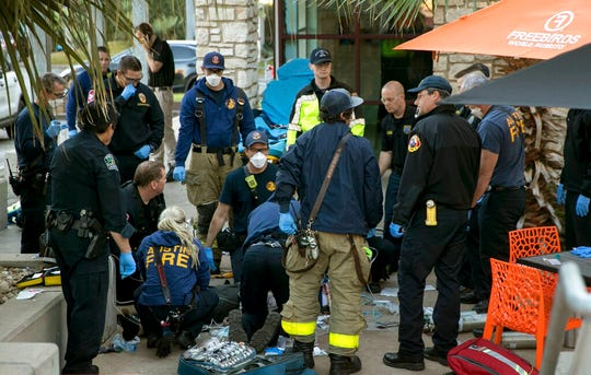 Paramedics perform CPR on a stabbing victim in Austin, Texas on Friday, Jan. 3, 2020.