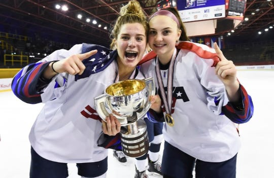 Okemos' Clara Van Wieren, left, and Audrey Wethington celebrate after Team USA won a gold medal with a 2-1 overtime win over Canada at the world U18 women's hockey championship on Thursday in Bratislava, Slovakia.