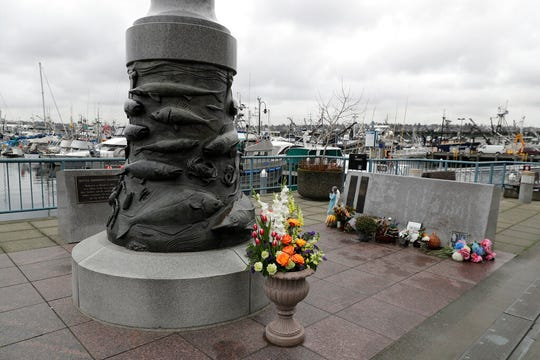 The Seattle Fishermen's Memorial is shown Thursday, Jan. 2, 2020 in Seattle. Items left at the memorial Thursday included a ball cap with the name of the crab fishing boat Scandies Rose.