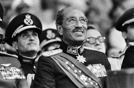 In this Oct. 6, 1981 file photo, Egyptian President Anwar Sadat smiles at the start of the military parade in Cairo. Later, during the parade, Sadat was killed with eleven others when gunmen opened fire on the reviewing stand.