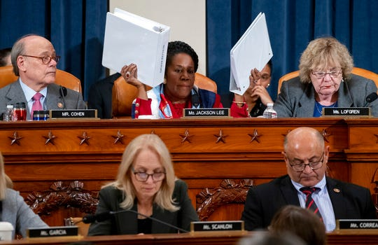 Rep. Sheila Jackson Lee, D-Texas, holds up copies of the Robert Mueller report as she questions constitutional scholars in Washington in this Dec. 4, 2019, file photo. Democrats in Congress are seeking access to grand jury testimony cited in special counsel Robert Mueller's Russia investigation. They think it might be useful for any impeachment trial of President Donald Trump.  A federal appeals court heard arguments Friday on whether the House can obtain the secret grand jury material.