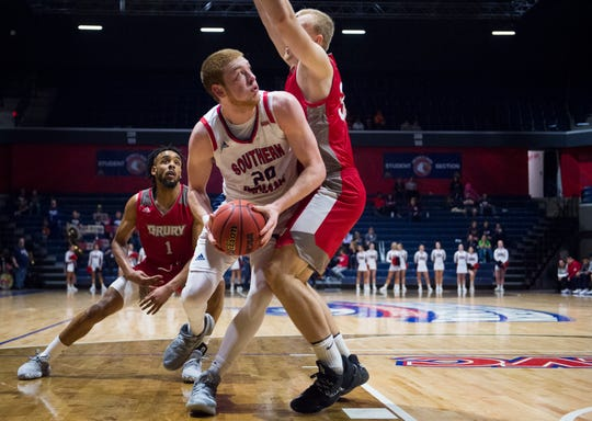 University of Southern Indiana's Justin Carpenter (20) looks up while driving to the basket during the University of Southern Indiana Screaming Eagles vs Drury Panthers game at Screaming Eagles Arena Thursday evening, Jan. 2, 2020.