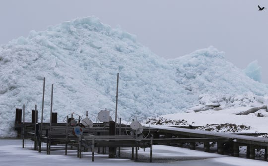 A giant ice shove looms at the docks in Oshkosh and engulfs the boat slips in March 2017, after a winter storm broke up shifting ice on Lake Winnebago.