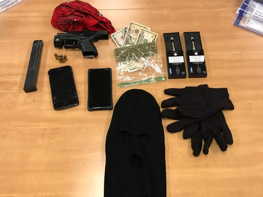 A loaded handgun, two ski masks, gloves, and drugs were found in a car pulled over for  driving 90 in a 50 mph zone.