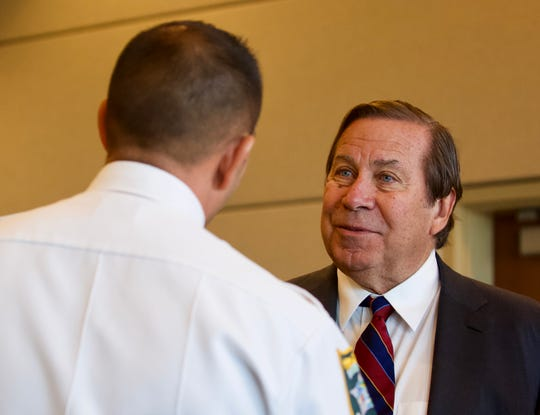 Dennis Murphy from Dateline talks with Lee County Sheriff Carmine Marceno during a motions hearing in the Mark Sievers case on Friday, January 3, 2020, at the Lee County Justice Center in Fort Myers.