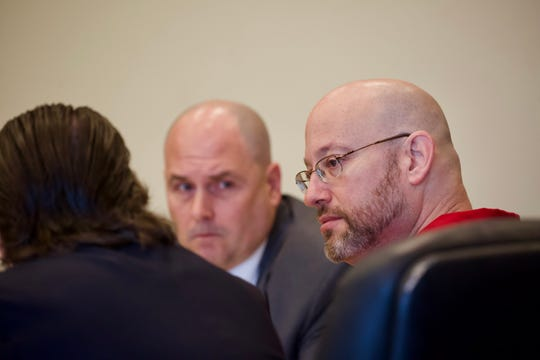 Mark Sievers listens to his attorney during a motions hearing in his case on Friday, January 3, 2020, at the Lee County Justice Center in Fort Myers.