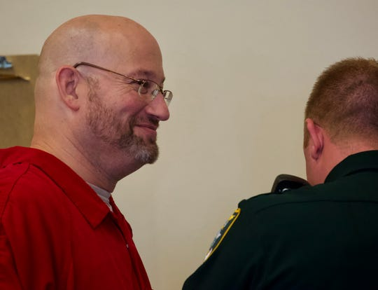 Mark Sievers smiles at his family as he submits his fingerprints after being sentenced to death. A last-ditch appeal by lawyers to save Mark Sievers' life was rejected by Judge Bruce Kyle on Friday, Jan. 3, 2020.