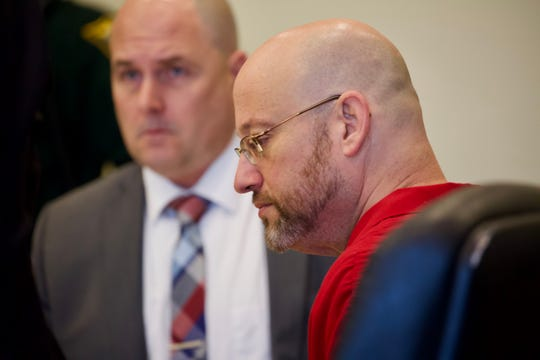 Mark Sievers sits with his attorneys during a motions hearing in his case on Friday, January 3, 2020, at the Lee County Justice Center in Fort Myers.