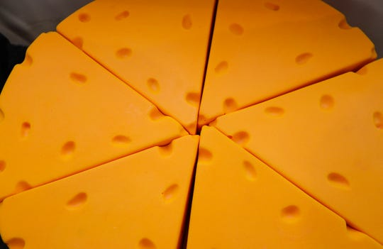 Slices of cheese heads are displayed on Friday, Jan. 3, 2020, at Jersey Store in Ashwaubenon, Wis. Ebony Cox/USA TODAY NETWORK-Wisconsin