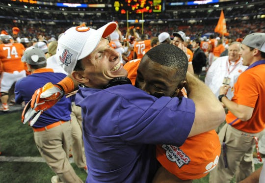 Clemson defensive coordinator Brent Venables hugs safety Robert Smith (27) after the Tigers defeated LSU 25-24 in the Chick-fil-A Bowl Monday, December 31, 2012 in the Georgia Dome in Atlanta. BART BOATWRIGHT/Staff