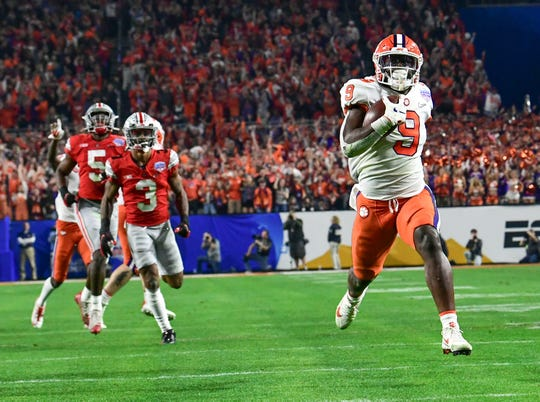 Clemson running back Travis Etienne (9) runs 53-yards after a catch for a touchdown during the third quarter of the PlayStation Fiesta Bowl of the College Football Playoffs semi-final game, at State Farm Stadium in Glendale, Arizona Saturday, December 28, 2019.