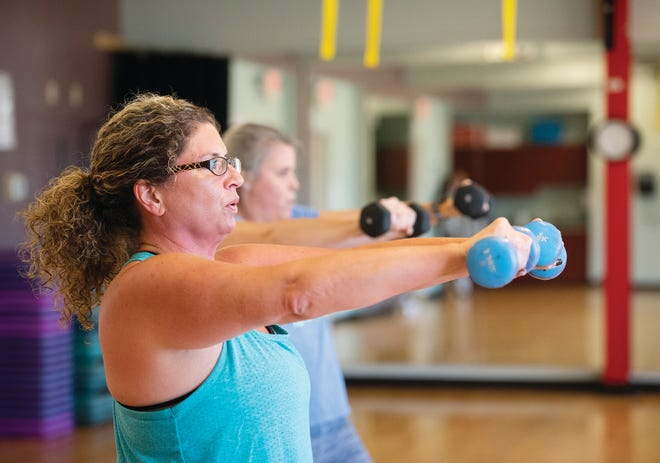 A group of women participate in a Lunch Blast exercise class at the George I. Theisen Family YMCA in Travelers Rest.
