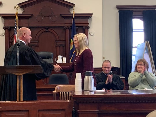 Judge John Kutzman swears in Tina Henry as chief deputy clerk on Friday, Jan. 2 after commissioners appointed her to the job to serve the remainder of the term of retiring Faye McWilliams. Henry has filed for election.