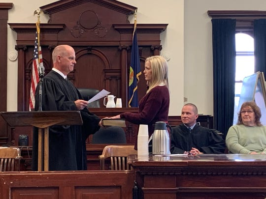 Cascade County District Judge John Kutzman swears in Tina Henry as chief deputy clerk on Friday, Jan. 2. Henry is replacing Faye McWilliams who held the position for eight-and-a-half years.