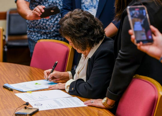 Gov. Lou Leon Guerrero signs Bill 181 into law during a bill signing ceremony at Adelup on Friday, Jan. 3, 2020. The new law will allow the use of local funds to advance the payment to still-living war survivors whose claims have been adjudicated.
