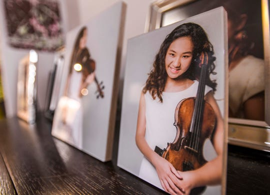 A collection of photographs of Justine Xu, 14, are displayed in her family's home at Barrigada Heights on Dec. 30, 2019. Xu, a St. John's School freshman born and raised on Guam, said she first learned to play the instrument when she was only five years old. Xu also performed in the prestigious musical venue, Carnegie Hall in New York City, in November 2019.