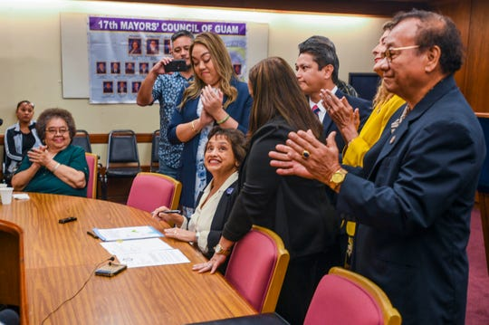 Gov. Lou Leon Guerrero is applauded by lawmakers, war survivors and others after she penned her signature to Bill 181 making it law during a bill signing ceremony at Adelup on Friday, Jan. 3, 2020. The new law will allow the use of local funds to advance the payment to still-living war survivors whose claims have been adjudicated.