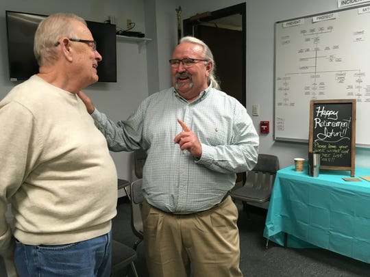 John Stroud talks with Mayor Steve Austin at his retirement reception on Dec. 27, 2019.
