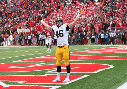 George Kittle, a future NFL star, scores the first touchdown of the game in Iowa's 28-20 win at Nebraska in 2015 that capped a 12-0 regular season.